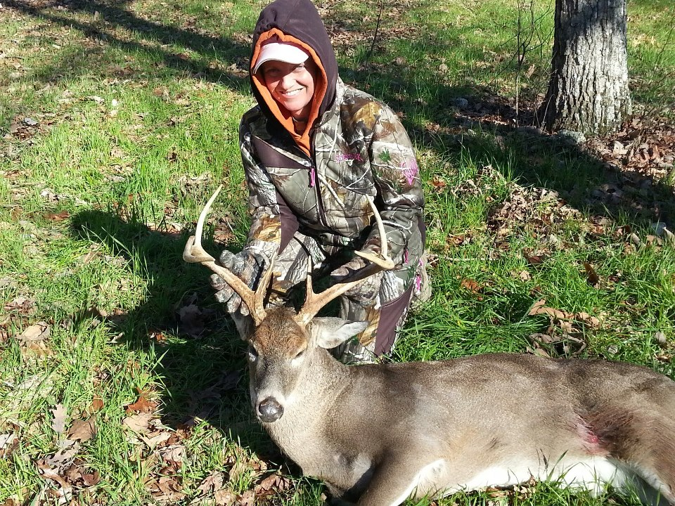 Female Hunter with Buck
